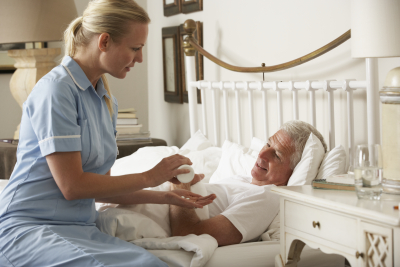 nurse giving senior man medication